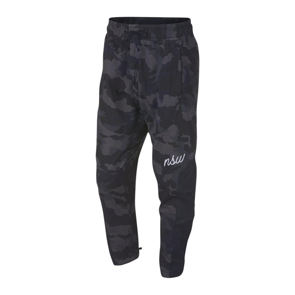 0b99b686a6ae6c Nike Sportswear NSW Men s Woven Camo Charcoal Jogger Pants. 061147AAAO5