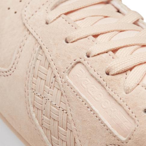 ce2fcb59491 Reebok Women s Classic Leather EMB Pink Peach Sneaker