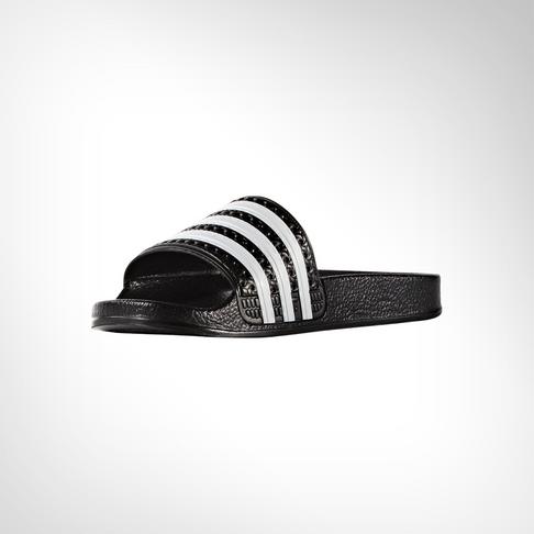77ab0259c882f0 Grade School adidas Adilette Black White Slide